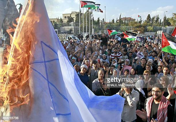 Jordanian protesters set a makeshift Israeli flag on fire during a demonstration calling for an end to the Israeli military offensive in the Gaza...