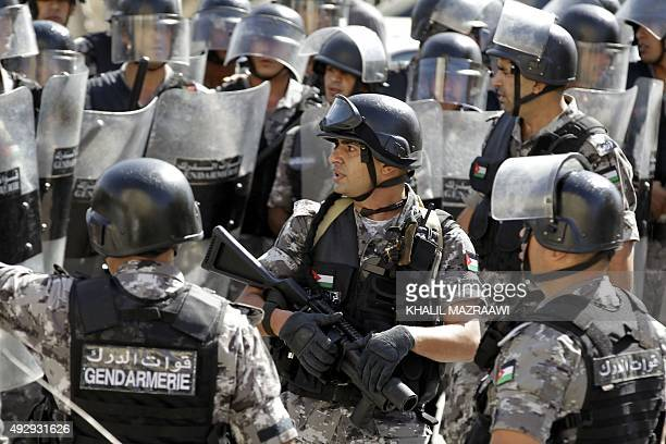 Jordanian riot police stand guard during a demonstration near the Israeli Embassy in the capital Amman in solidarity with the Palestinians on October...