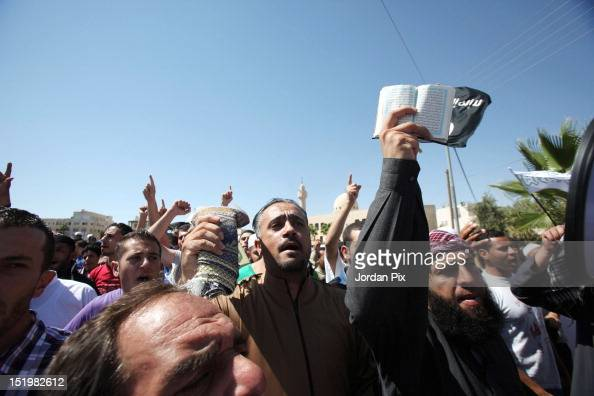 Jordanian Salafis demonstrate near the US embassy in reaction to a the film 'Innocence of Islam' near the US Embassy September 14 2012 in Amman...