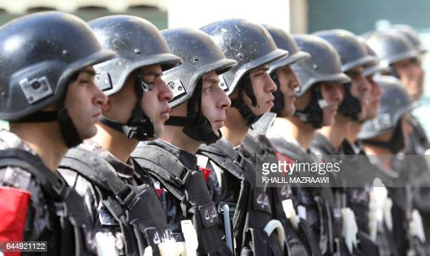 Jordanian security forces are seen during a protest after the Friday prayer in the capital Amman on February 24 2017 against the government's...