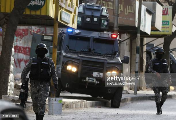 Jordanian security forces secure a street in the town of Irbid 80 kms north of the capital Amman near the border with Syria on March 2 following a...