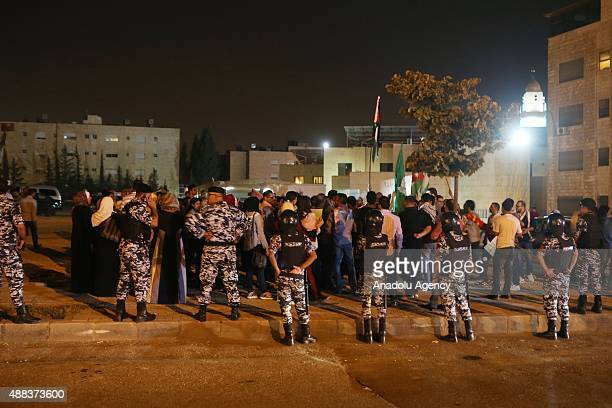 Jordanian security forces stand guard as a group of demonstrators protest the Israeli violations at Al Aqsa Mosque outside Israeli Embassy in Amman...
