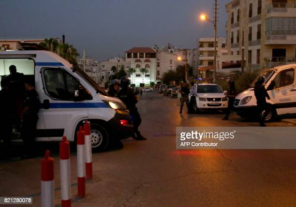 Jordanian security forces stand guard outside the Israeli embassy in the residential Rabiyeh neighbourhood of the capital Amman following an...