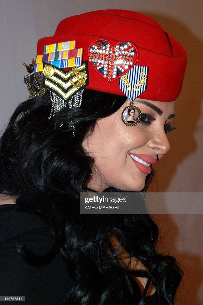 Jordanian singer Diana Curzon poses on the red carpet upon her arrival for the Dear Guest (DG) Egyptian English magazine's yearly event on January 19, 2013 in Cairo. AFP PHOTO AMRO MARAGHI