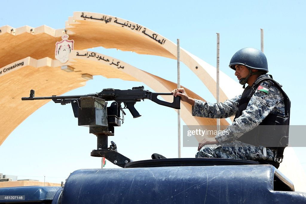 A Jordanian soldier on a military vehicle secures the area near the AlKarameh border point with Iraq on June 25 2014 as Jordan reinforced its border...