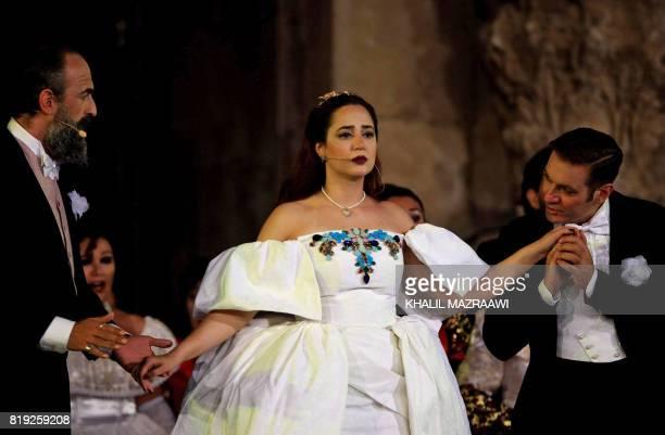 Jordanian soprano Zeina Barhoum as Violetta Valery performs Giuseppe Verdi's La Traviata directed by Luigi Orfeo and conducted by Lorenzo Tazzieri...