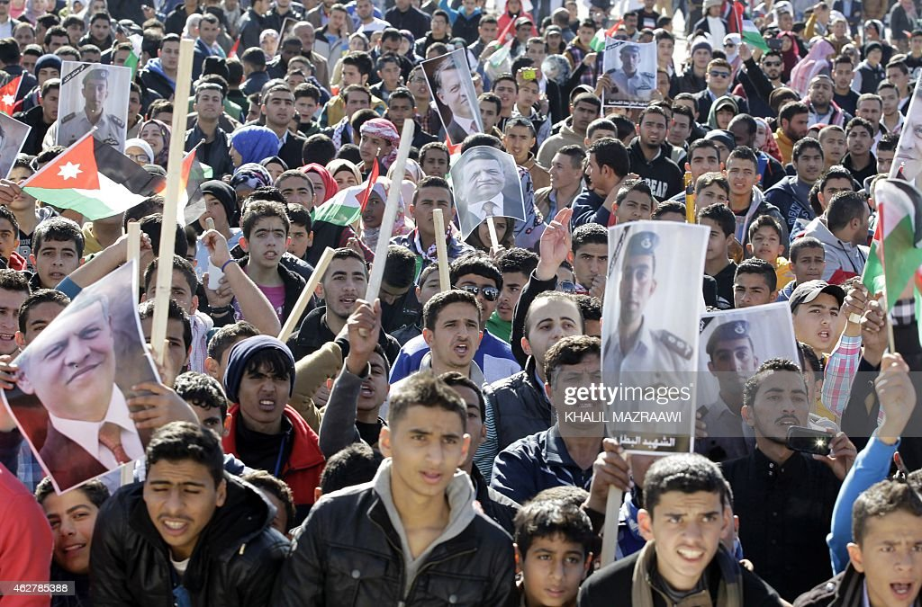 Jordanian students shout slogans on February 5 2015 in the capital Amman during a rally against the Islamic state group and in reaction to the...