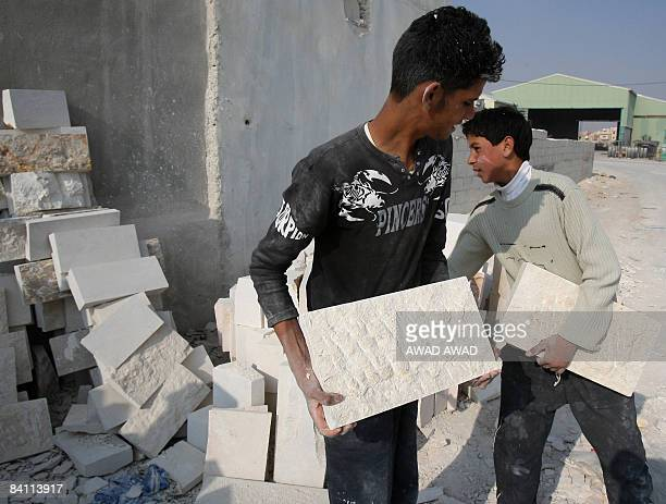 HATTAR Jordanian teenagers work at a stone cutting workshop in the inudstrial area of Sahab 40 kms south of Amman on December 22 2008 there are an...