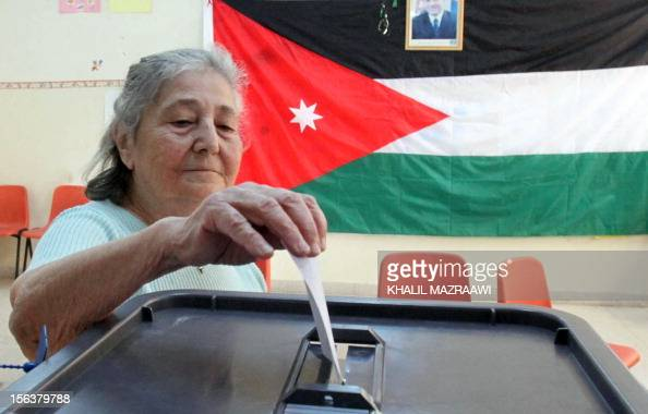 A Jordanian woman casts her ballot at a polling station in Amman on November 9 in an early general election likely to produce MPs with tribal links...