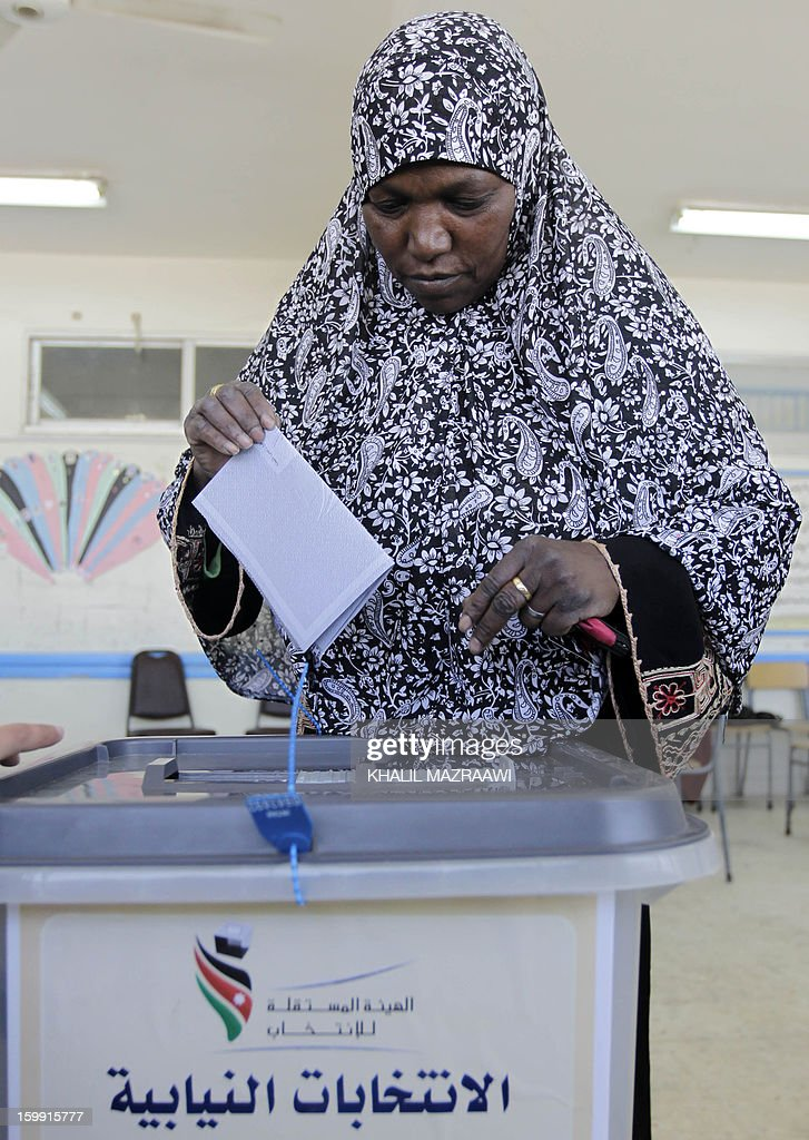 A Jordanian woman casts her ballot at a polling station in the Palestinian refugee camp of Baqaa, north of Amman, on January 23, 2013. Jordanians are voting in a parliamentary poll snubbed by Islamists who have staged strident pro-reform protests and who have already slammed what is expected to be an opposition-free body as illegitimate. AFP PHOTO/KHALIL MAZRAAWI