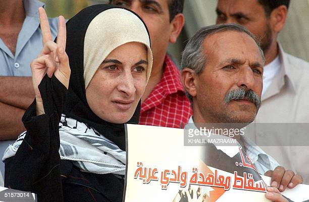 Jordanian woman holds an Arabic banner reading 'Together to torpedo the Wadi Araba agreement' during a protest against the peace treaty Jordan signed...