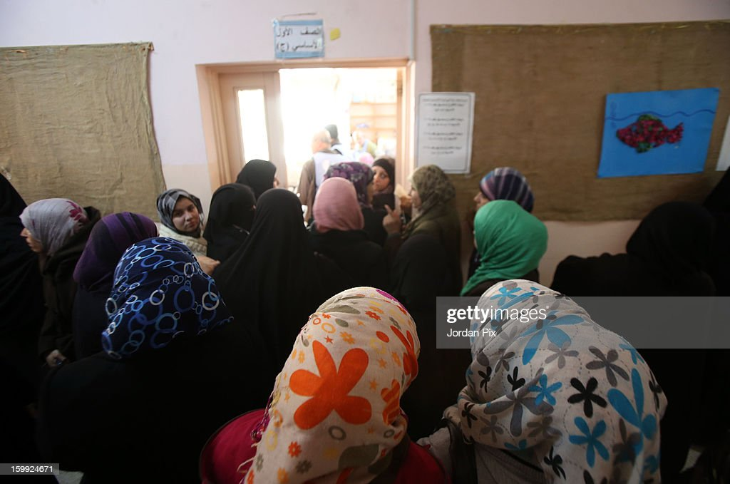 Jordanian women queue to vote in the parliamentary elections on January 23, 2013 in the city of Zarqa, Jordan. Jordan's election has come under criticism with claims that they are not democratic elections despite King Abdullah of Jordan's promise that the elections will see a popularly-elected candidate become prime minister for the first time.