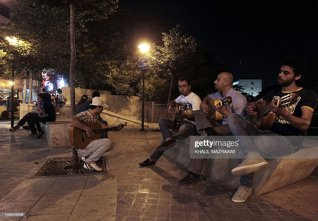 Jordanian youths play their guitars at Rainbow Street in Amman on May 62012 Rainbow Street in Amman's heart is abuzz again after posh 1920sera homes...