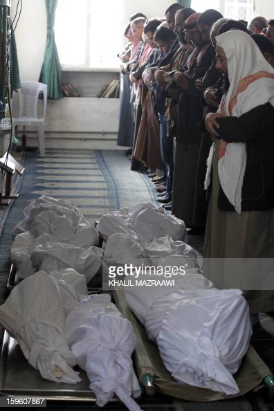 Jordanians and Syrians pray in front of the bodies of the Syrian refugees who were killed the day before during an explosion during their funeral in...