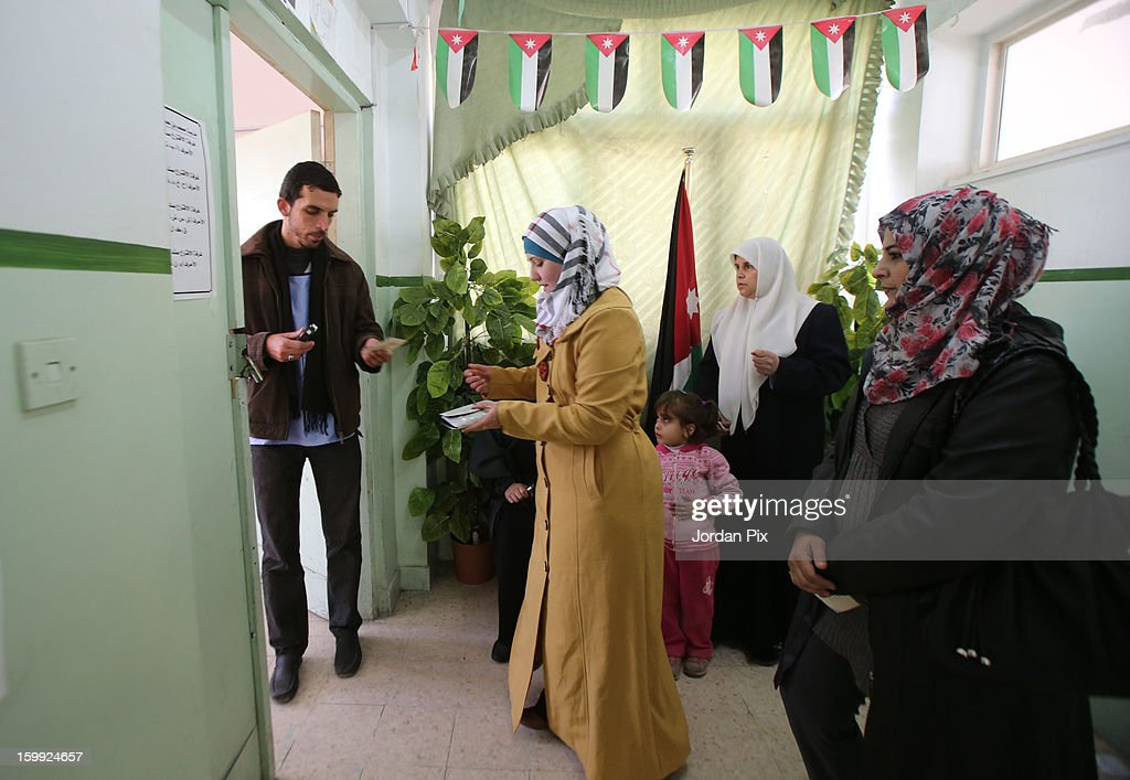 Jordanians arrive to vote in the parliamentary elections on January 23, 2013 in the city of Zarqa, Jordan. Jordan's election has come under criticism with claims that they are not democratic elections despite King Abdullah of Jordan's promise that the elections will see a popularly-elected candidate become prime minister for the first time.