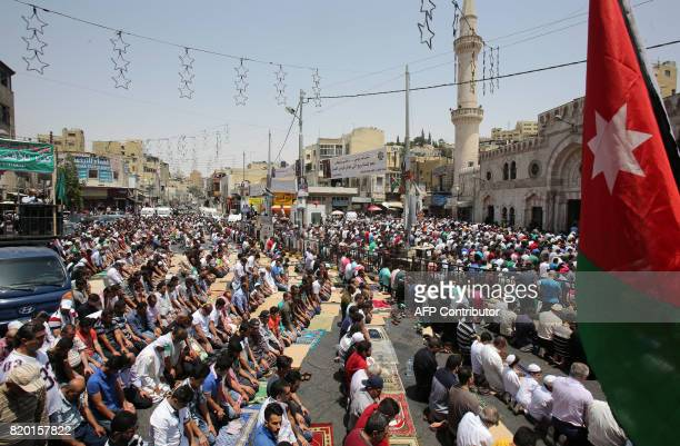 Jordanians attend Friday prayers ahead of demonstration called for by the Islamic Action Front in Amman on July 21 to protest against new Israeli...