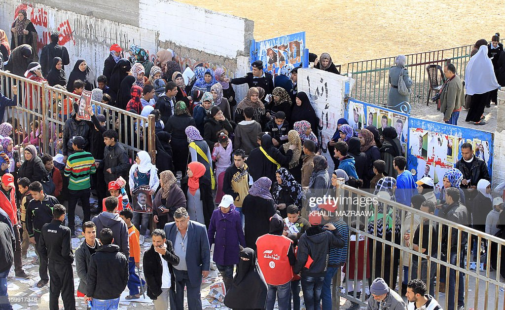 Jordanians queue outside a polling station in the Palestinian refugee camp of Baqaa, north of Amman, on January 23, 2013. Jordanians are voting in a parliamentary poll snubbed by Islamists who have staged strident pro-reform protests and who have already slammed what is expected to be an opposition-free body as illegitimate. AFP PHOTO/KHALIL MAZRAAWI