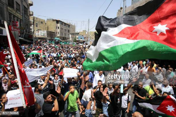 Jordanians shout slogans during a demonstration called for by the Islamic Action Front in Amman following friday prayers on July 21 to protest...