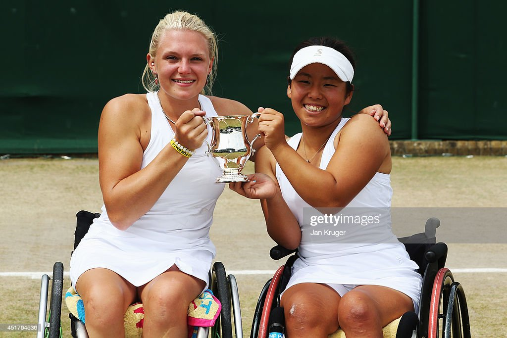 <a gi-track='captionPersonalityLinkClicked' href=/galleries/search?phrase=Jordanne+Whiley&family=editorial&specificpeople=7454060 ng-click='$event.stopPropagation()'>Jordanne Whiley</a> of Great Britain (l) and <a gi-track='captionPersonalityLinkClicked' href=/galleries/search?phrase=Yui+Kamiji&family=editorial&specificpeople=9691203 ng-click='$event.stopPropagation()'>Yui Kamiji</a> of Japan celebrate with the trophy after winning their Ladies' Wheelchair Doubles Final match against Jiske Griffioen and Aniek Van Koot of Netherlands on day thirteen of the Wimbledon Lawn Tennis Championships at the All England Lawn Tennis and Croquet Club on July 6, 2014 in London, England.