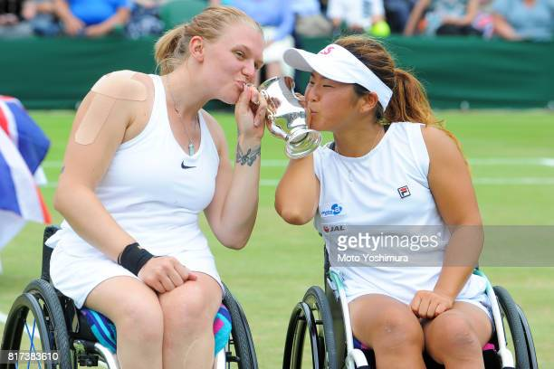 Jordanne Whiley of Great Britain and Yui Kamiji of Japan celebrate with the trophy after winning their Ladies' Wheelchair doubles final against...