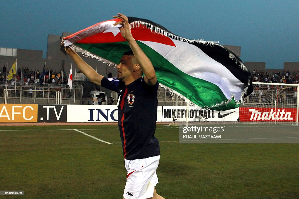 Jordan's Ahmad Ibrahim (10) celebrates after Jordan beat Japan 2-1 following their FIFA World Cup Group B Asian qualifiers round four football match, in Amman, on March 26, 2013. AFP PHOTO/KHALIL MAZRAAWI