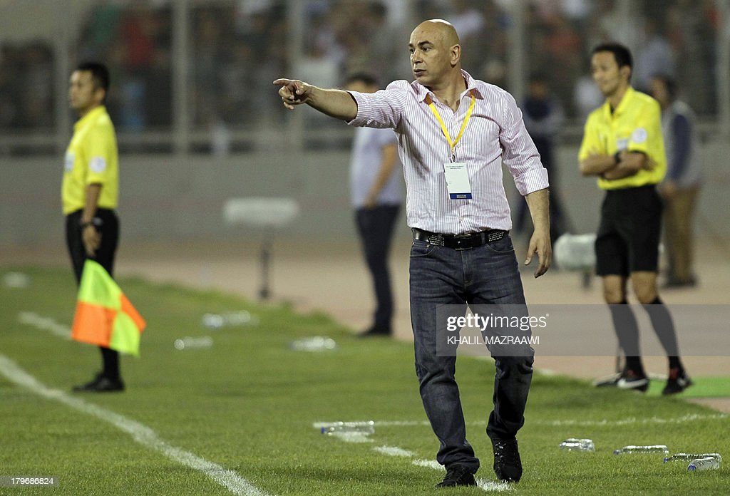 Jordan's coach Hossam Hassan (C) gives instructions to his team from the side of the pitch during their 2014 World Cup qualifier football match against Uzbekistan at the King Abdullah international stadium in Amman on September 6, 2012. The match ended in a draw.
