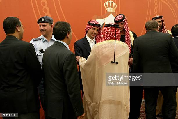 Jordan's Crown Prince Hamzeh bin alHussein is greeted by Bedouin tribal leaders as Prince Ghazi bin Mohamed the cousin of the Crown Prince and Prince...