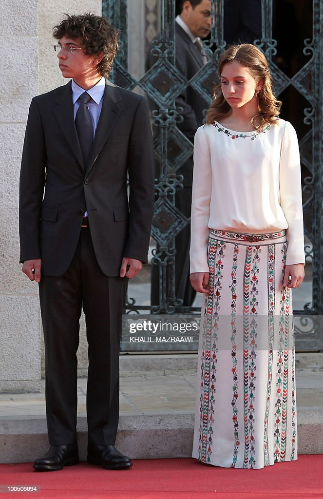 Jordan's Crown Prince Hussein, the eldest son of Jordan's King Abdullah II, and his sister Princess Eman attend a ceremony celebrating Independence Day in Amman on May 25, 2010.