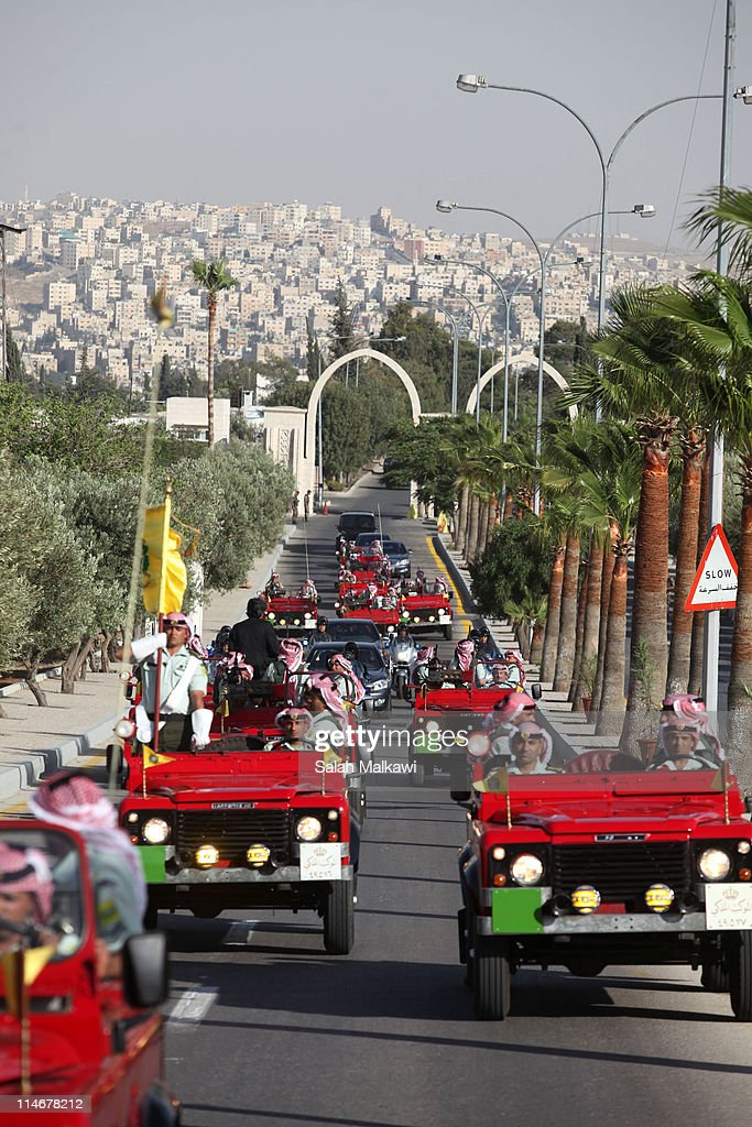 Jordan's King Abdullah driving in a motorcade in a street of Amman arrives at an official celebration for the 65th anniversary of Independence on May 25, 2011 in Amman, Jordan. The Hashemite Kingdom of Jordan gained independence from Britain on May 25, 1946.