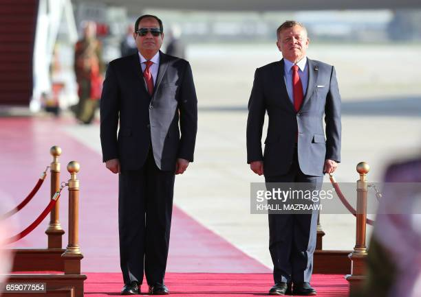 Jordan's King Abdullah II and Egyptian President Abdel Fattah alSisi listen to their national anthems during a welcome ceremony for the latter at the...