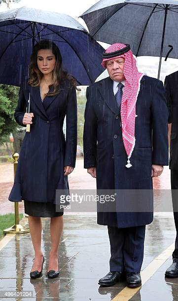 Jordan's King Abdullah II and his wife Queen Rania observe a moment of silence during a memorial service for the victims of the 2005 Amman bombings...