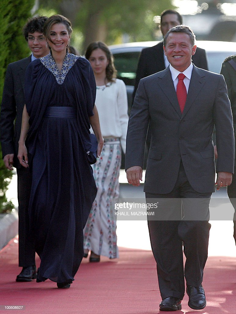 Jordan's King Abdullah II and Queen Rania arrive to attend a ceremony celebrating Independence Day in Amman on May 25, 2010.