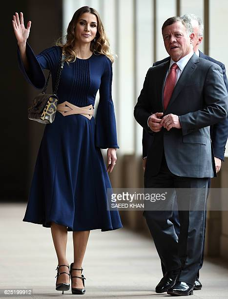 Jordan's King Abdullah II and Queen Rania walk along the wall of poppies during their visit to the Australian War Memorial in Canberra on November 23...