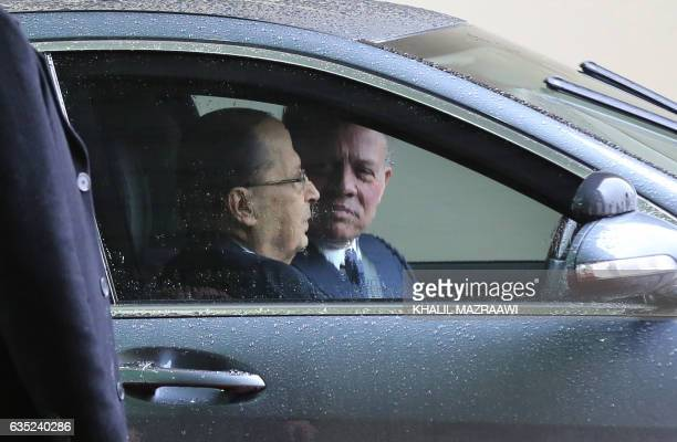 Jordan's King Abdullah II drives Lebanese President Michel Aoun following an official welcome ceremony at Marka airport in Amman on February 14 2017...