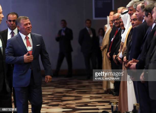 Jordan's King Abdullah II greets world leaders and delegates during the opening session of the World Economic Forum held in the Dead Sea resort of...