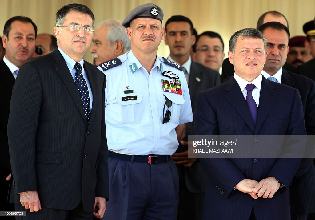 Jordan's King Abdullah II (R), his brother Prince Faisal (C) and Royal Jordanian President and CEO Hussein Dabbas (L), attend a ceremony to receive two new Airbus A330-200 acquired by state carrier Royal Jordanian at Queen Alia International Airport in Amman May 24, 2010. The ceremony was held as part of Independence Day celebrations.