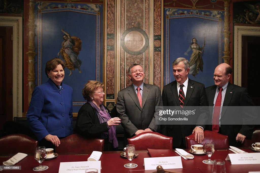 Jordan's King Abdullah II (C) laughs with members of the Appropriations Committee (L-R) Sen. <a gi-track='captionPersonalityLinkClicked' href=/galleries/search?phrase=Jeanne+Shaheen&family=editorial&specificpeople=5591285 ng-click='$event.stopPropagation()'>Jeanne Shaheen</a> (D-NH), Chairman Barbara Mikulski (D-MD), Sen. <a gi-track='captionPersonalityLinkClicked' href=/galleries/search?phrase=Mike+Johanns&family=editorial&specificpeople=584233 ng-click='$event.stopPropagation()'>Mike Johanns</a> (R-NE) and Sen. Chris Coons (D-DE) before a meeting at the U.S. Capitol February 12, 2014 in Washington, DC. King Abdullah is meeting with members of Congress, Vice President Joe Biden and will meet with President Barack Obama on Friday in California.
