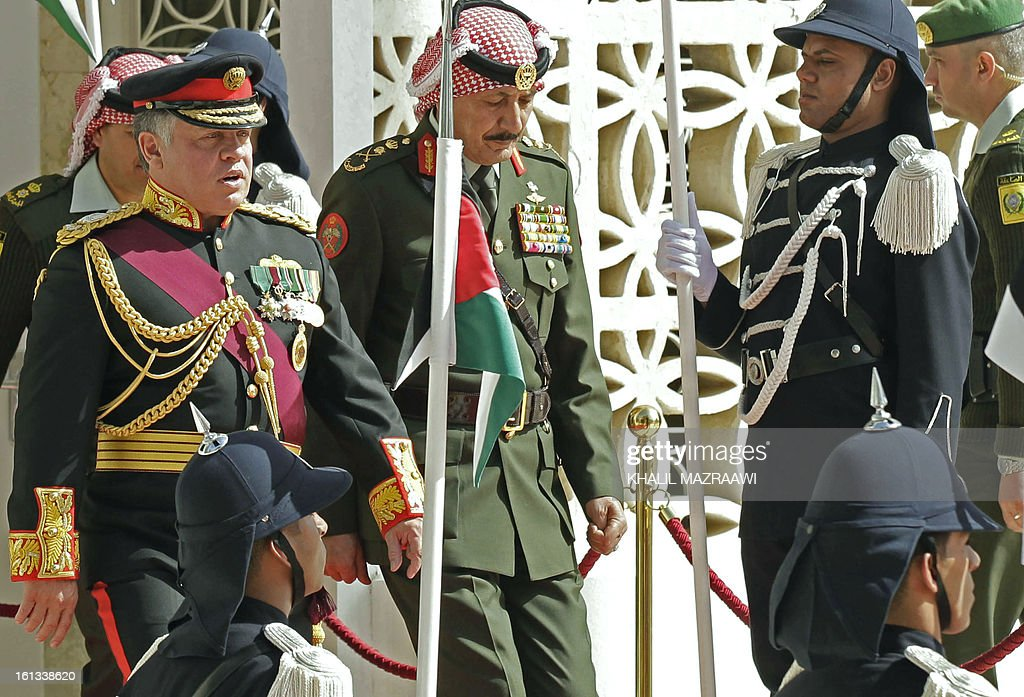 Jordan's King Abdullah II (L) leaves the Jordanian parliament after addressing the opening of the parliament in the capital Amman on February 10, 2013. King Abdullah told newly elected members of parliament that he seeks to reach 'consensus' with them before naming a prime minister, and hailed the 'historic transformation' towards parliamentary government in Jordan.