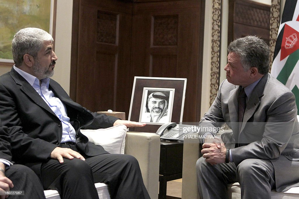 Jordan's King Abdullah II (R) meets with Hamas chief Khaled Meshaal in Amman on January 28, 2013. Hamas chief is holding talks with Jordan's King over Palestinian reconciliation efforts.