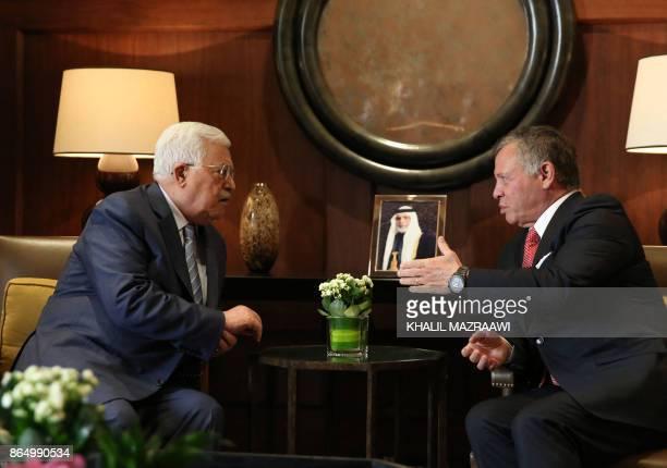 Jordan's King Abdullah II meets with Palestinian leader Mahmud Abbas on October 22 in Amman / AFP PHOTO / KHALIL MAZRAAWI