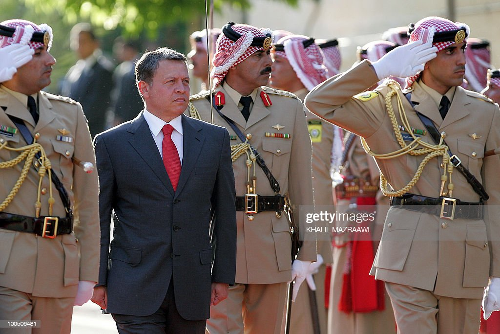 Jordan's King Abdullah II reviews a bedouin honour guard upon his arrival to attend a ceremony celebrating Independence Day in Amman on May 25, 2010.