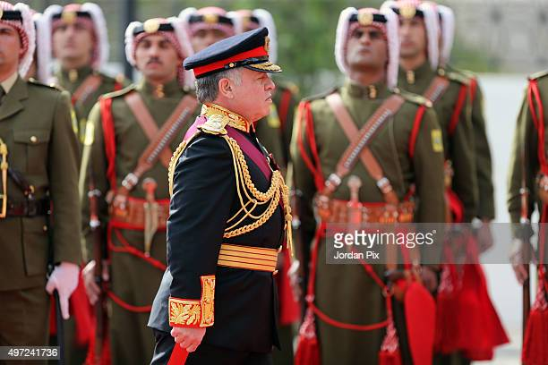 Jordan's king Abdullah II reviews the honor guard at a special ceremony as he inaugurates the Jordanian Parliament third ordinary session giving a...