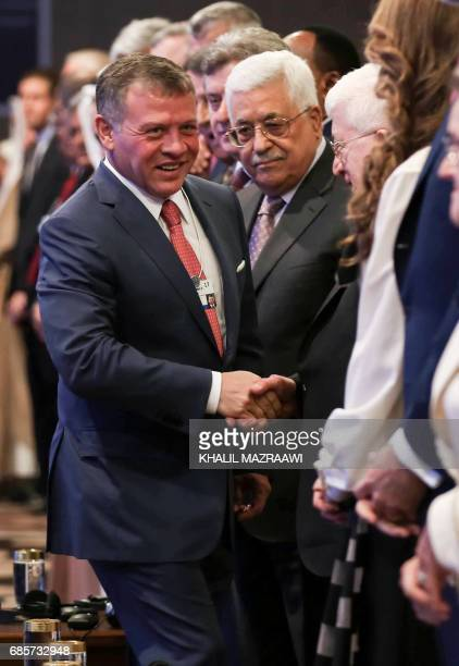 Jordan's King Abdullah II shakes hands with Iraqi President Fuad Masum during the opening session of the World Economic Forum held in the Dead Sea...