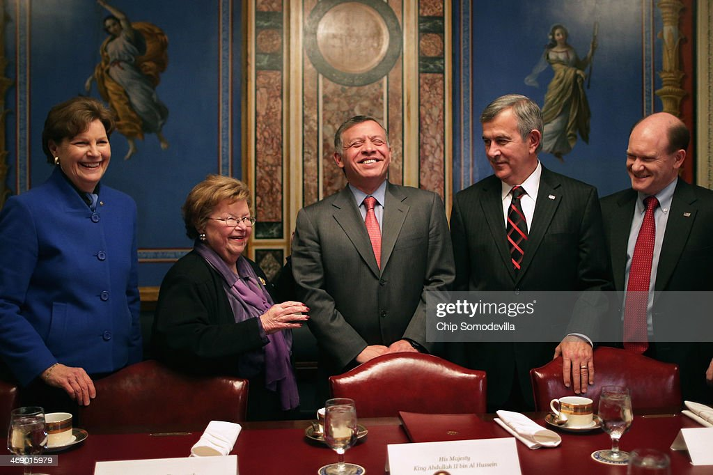 Jordan's King Abdullah II (C) shares a laugh with members of the Appropriations Committee (L-R) Sen. <a gi-track='captionPersonalityLinkClicked' href=/galleries/search?phrase=Jeanne+Shaheen&family=editorial&specificpeople=5591285 ng-click='$event.stopPropagation()'>Jeanne Shaheen</a> (D-NH), Chairman <a gi-track='captionPersonalityLinkClicked' href=/galleries/search?phrase=Barbara+Mikulski&family=editorial&specificpeople=226768 ng-click='$event.stopPropagation()'>Barbara Mikulski</a> (D-MD), Sen. <a gi-track='captionPersonalityLinkClicked' href=/galleries/search?phrase=Mike+Johanns&family=editorial&specificpeople=584233 ng-click='$event.stopPropagation()'>Mike Johanns</a> (R-NE) and Sen. Chris Coons (D-DE) before a meeting at the U.S. Capitol February 12, 2014 in Washington, DC. King Abdullah is meeting with members of Congress, Vice President Joe Biden and will meet with President Barack Obama on Friday in California.
