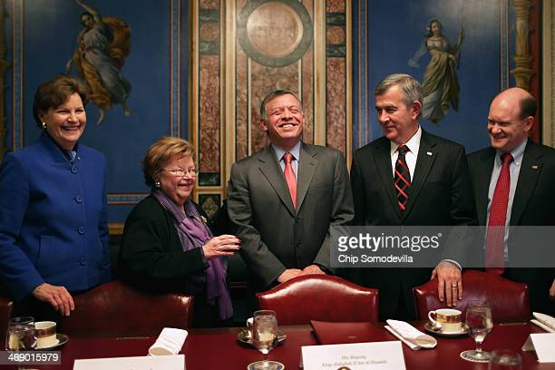 Jordan's King Abdullah II shares a laugh with members of the Appropriations Committee Sen Jeanne Shaheen Chairman Barbara Mikulski Sen Mike Johanns...