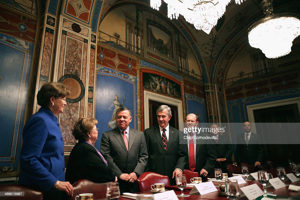 Jordan's King Abdullah II (3rd L) smiles with members of the Appropriations Committee (L-R) Sen. <a gi-track='captionPersonalityLinkClicked' href=/galleries/search?phrase=Jeanne+Shaheen&family=editorial&specificpeople=5591285 ng-click='$event.stopPropagation()'>Jeanne Shaheen</a> (D-NH), Chairman <a gi-track='captionPersonalityLinkClicked' href=/galleries/search?phrase=Barbara+Mikulski&family=editorial&specificpeople=226768 ng-click='$event.stopPropagation()'>Barbara Mikulski</a> (D-MD), Sen. <a gi-track='captionPersonalityLinkClicked' href=/galleries/search?phrase=Mike+Johanns&family=editorial&specificpeople=584233 ng-click='$event.stopPropagation()'>Mike Johanns</a> (R-NE) and Sen. Chris Coons (D-DE) before a meeting at the U.S. Capitol February 12, 2014 in Washington, DC. King Abdullah is meeting with members of Congress, Vice President Joe Biden and will meet with President Barack Obama on Friday in California.
