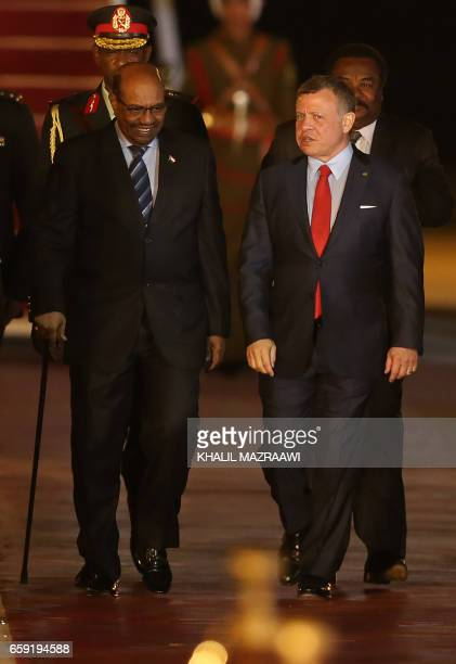 Jordan's King Abdullah II welcomes Sudanese President Omar alBashir at a welcome ceremony at the Queen Alia International Airport in Amman on March...