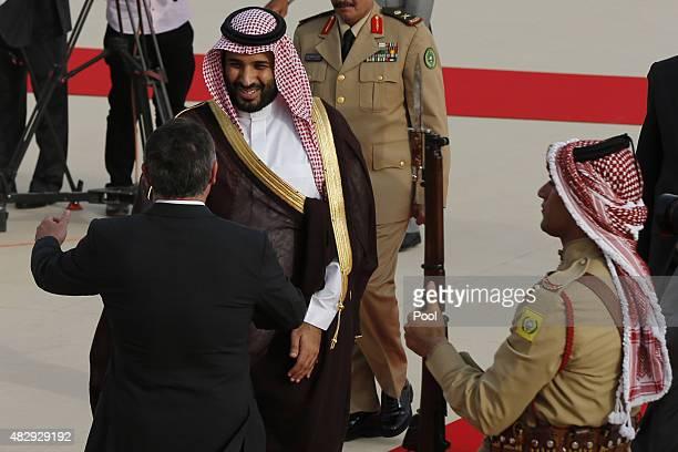 Jordan's King Abdullah welcomes Saudi Arabia's Deputy Crown Prince Mohammed bin Salman upon his arrival at the Royal Palace on August 4 2015 in Amman...