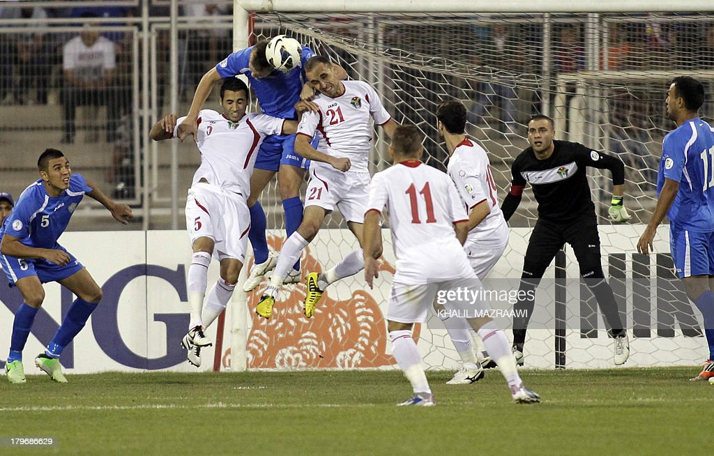 Jordan's Mohammad Mustafa Hassan Ali (2L), Mohammad al-Dumeiri (4L), Oday Zahran (3L) try to defend against a shot on goal by Uzbekistan during their 2014 World Cup qualifier football match at the King Abdullah international stadium in Amman on September 6, 2012. The match ended in a draw.