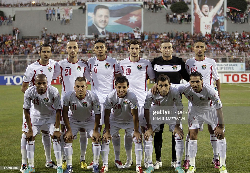 Jordan's national team pose for a photo prior to their 2014 World Cup qualifier football match against Uzbekistan at the King Abdullah international stadium in Amman on September 6, 2012. The match ended in a draw. AFP PHOTO/KHALIL MAZRAAWI